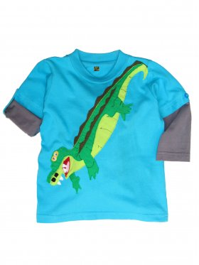 A must-have for any crocodile-loving boy out there! This long-sleeved t-shirt features an inside button tab to easily roll up sleeves. Hand-made out of 100% cotton and machine-washable. Available sizes: 1 - 5 years.